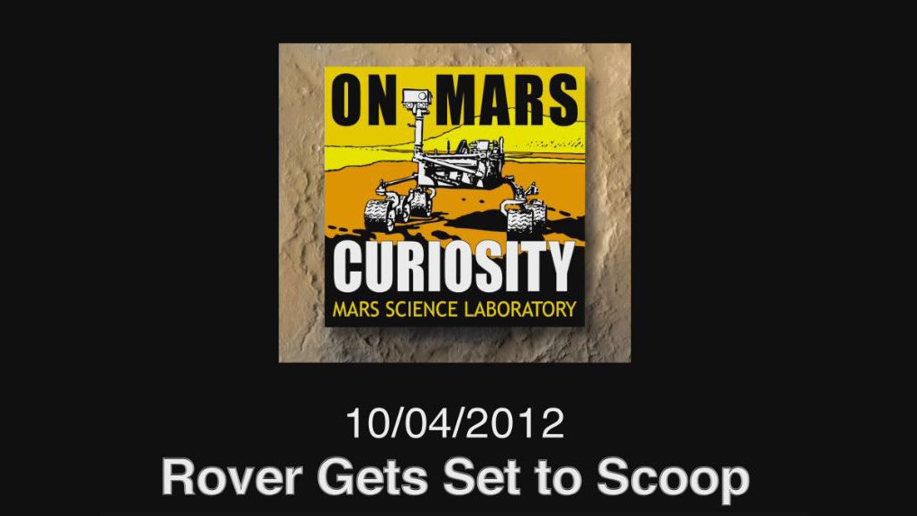 see the image 'Rover Gets Set to Scoop'