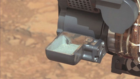 see the image 'Curiosity Collects First Rock Sample on Mars'