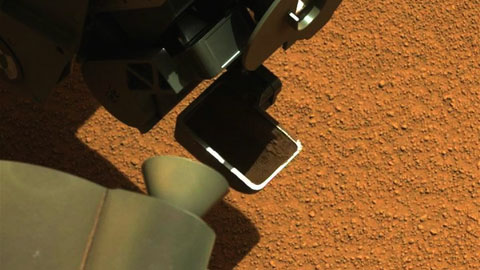 see the image 'Curiosity's First Scoop of Mars, in Vibration Movie'