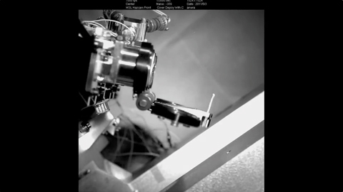 see the image 'Popping the Lid off Curiosity's Hazard Cameras'