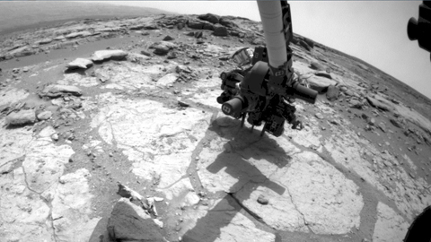 see the image 'Curiosity Mars Rover Drilling Into Its Second Rock'