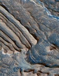 Rhythmic bedding in sedimentary bedrock within Becquerel crater on Mars is suggested by the patterns in this image from the High Resolution Imaging Science Experiment (HiRISE) camera on NASA's Mars Reconnaissance Orbiter.
