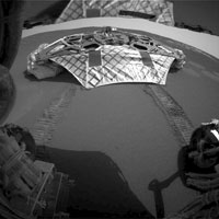 This image captured by the Mars Exploration Rover Opportunity's rear hazard-avoidance camera shows the now-empty lander that carried the rover 283 million miles to Meridiani Planum, Mars.