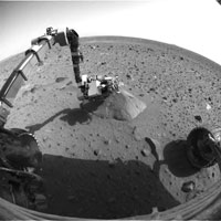 This image from Spirit's front hazard-avoidance camera shows the robotic arm extended to the rock called Adirondack.