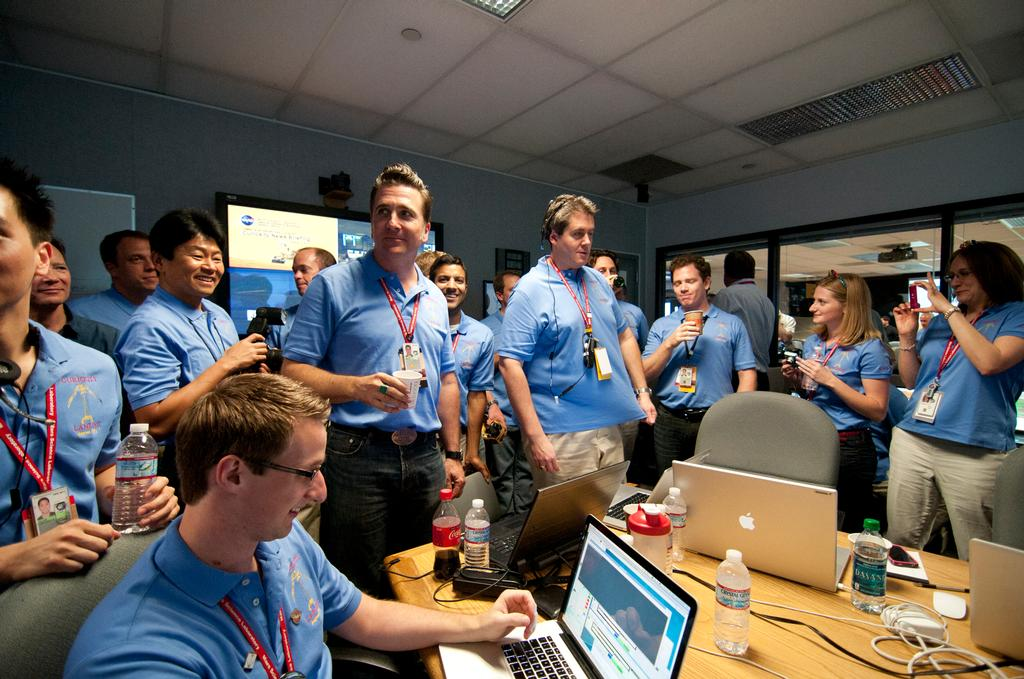 The Entry, Descent and Landing team gathers to celebrate prior to a post-landing press briefing.