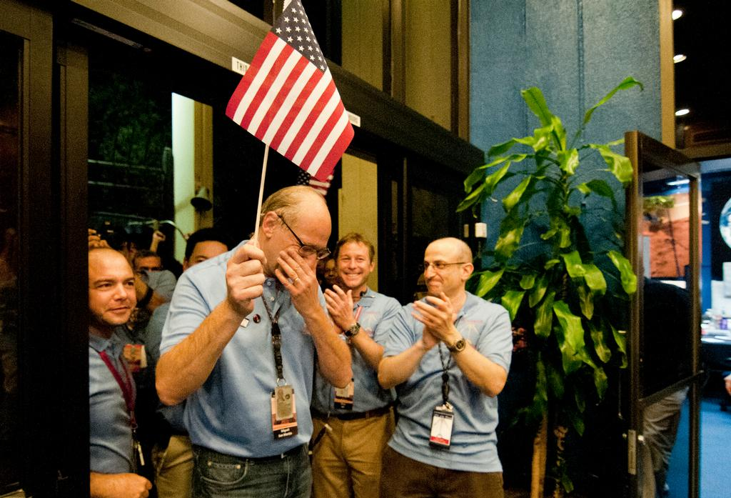 Miguel San Martin, Chief Engineer for Guidance, Navigation and Control for the Curiosity rover, pauses to hold back tears as he leads the Entry, Descent and Landing team into the post-landing news briefing.