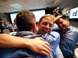 The Entry, Descent and Landing team celebrate just moments after news that Curiosity landed safely on Mars.