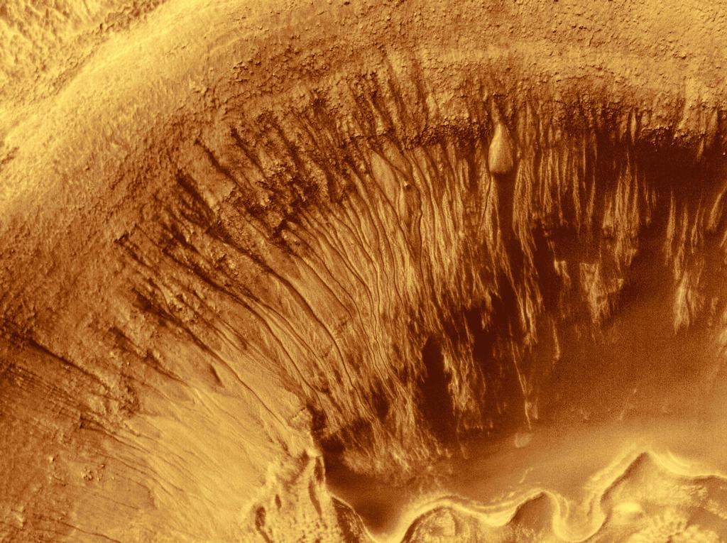 Newton Crater on Mars is a large basin formed by an asteroid impact that probably occurred more than 3 billion years ago. It is approximately 287 km (178 miles) across.