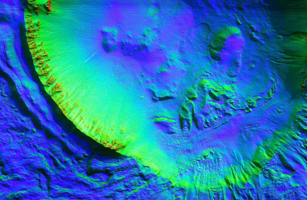 This unnamed impact crater is about 8 kilometers in diameter and contains numerous gullies.