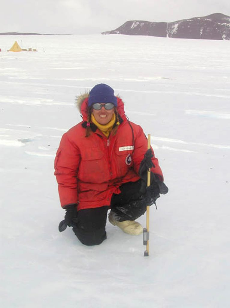 Dr. Nancy Chabot of Case Western Reserve University with the Arkansas-Oklahoma Center for Space and Planetary Sciences radiation dosimetry experiment near the Darwin Glacier, Antarctica.