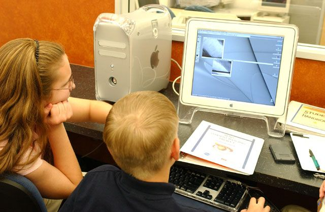 Students looking at a computer while participating in the Mars Student Imaging Project