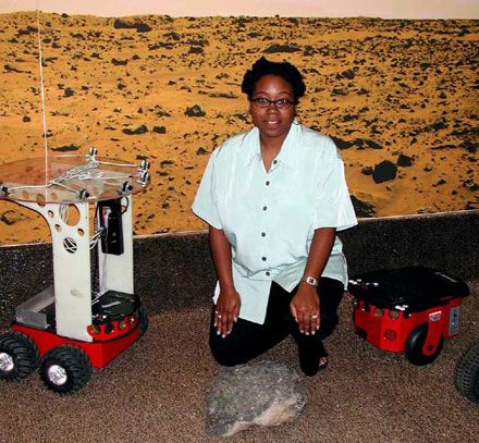 Dr. Ayanna Howard with the Safe Navigation Rover, designed to assess the terrain using human-based logic and choose safe paths accordinlgy.