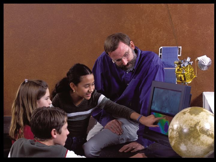 Dr. Phil Christensen, Principal Investigator for THEMIS, works with students to enable them to take pictures of Mars with the cameras on Odyssey.