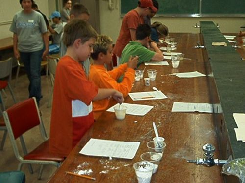 Middle school students with the GRS team, doing an experiment.