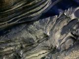 read the article 'NASA Spacecraft Read Layered Clues to Changes on Mars'