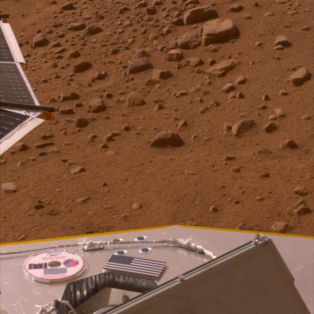 This color image shows a miniature U.S. flag on the deck of the Phoenix Mars Lander shortly after its arrival near the Martian north pole.