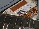 This color image shows a miniature U.S. flag on a petal of the landing platform beneath NASA's Spirit rover.