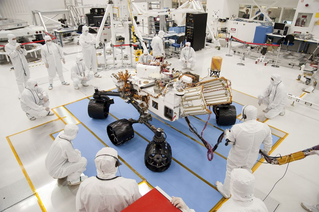 Technicians and engineers in clean-room garb monitor the first drive test of NASA's Curiosity rover, on July 23, 2010.