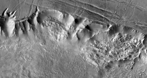 This image shows a 90-mile-wide portion of the giant Valles Marineris canyon system. Landslide debris and gullies in the canyon walls on Mars can be seen at 100 meters (330 feet) per pixel.