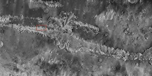 "Valles Marineris, the ""Grand Canyon of Mars,"" sprawls wide enough to reach from Los Angeles to nearly New York City, if it were located on Earth. The red outline box shows the location of a second, full-resolution image."
