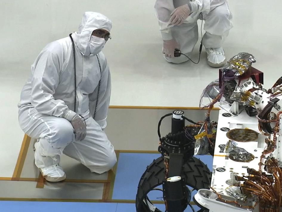 Mars Curiosity team members gather in the clean room at NASA's Jet Propulsion Laboratory to watch the rover roll for the first time.