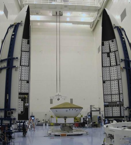 The Curiosity rover sits inside its protective aeroshell and is being encapsulated in the rocket fairings that will protect it during launch from Kennedy Space Center on Nov. 25, 2011.