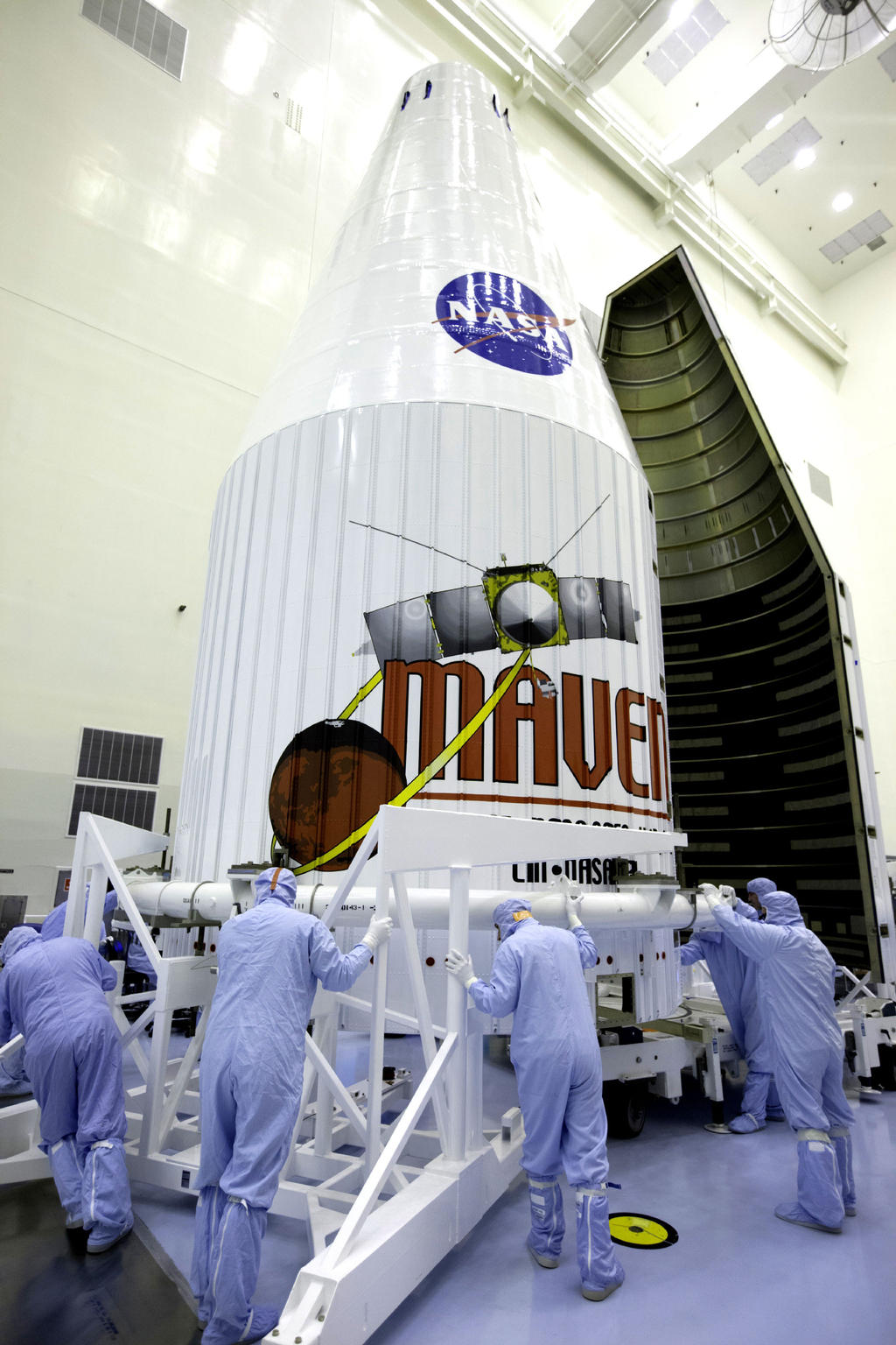 The payload fairing for the Mars Atmosphere and Volatile Evolution, or MAVEN, spacecraft arrives at the Payload Hazardous Servicing Facility at NASA's Kennedy Space Center in Florida.