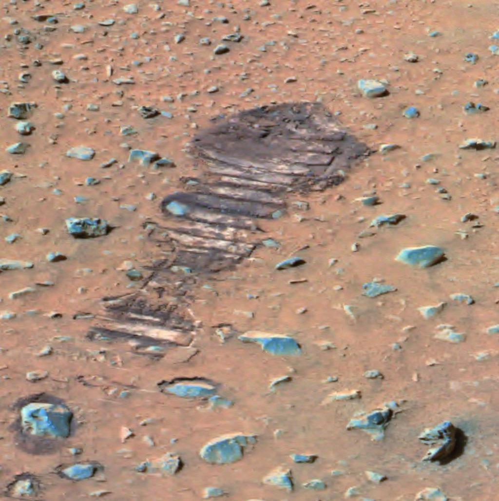 "This mosaic was acquired on Sol 36 (February 8, 2004) by the Spirit rover's panoramic camera (Pancam). Spirit performed measurements on a rock called ""Adirondack,"" which is visible at the top of this mosaic. This false color image brings out subtle color differences in the scene."
