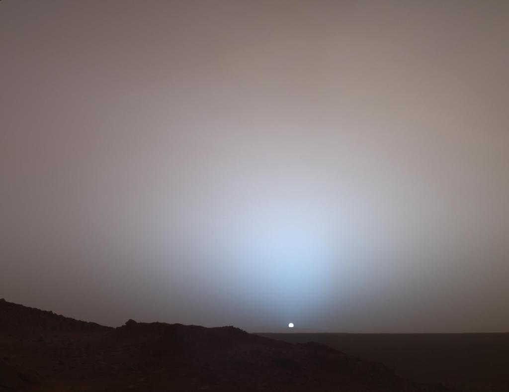 On May 19th, 2005, NASA's Mars Exploration Rover Spirit captured this stunning view as the Sun sank below the rim of Gusev crater on Mars.