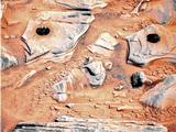 "NASA's Mars Exploration Rover Spirit acquired this false-color image on Mars during the rover's 746th Martian day, or sol, after using the rock abrasion tool to brush the surfaces of rock targets informally named ""Stars"" (left) and ""Crawfords"" (right)."