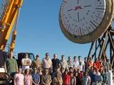 NASA's Low-Density Supersonic Decelerator team gathers around the a Supersonic Inflatable Aerodynamic Decelerator.