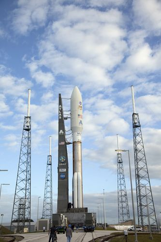 The 197-foot-tall United Launch Alliance Atlas V rocket seems surrounded by lightning masts as it arrives at the launch pad at Space Launch Complex 41 on Cape Canaveral Air Force Station in Florida. Atop the rocket is NASA's Mars Science Laboratory (MSL), enclosed in its payload fairing.