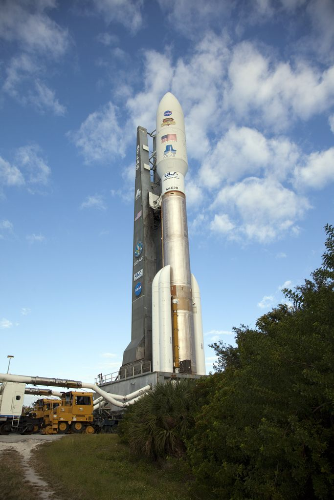 On Cape Canaveral Air Force Station in Florida, the 197-foot-tall United Launch Alliance Atlas V rocket rolls to the launch pad at Space Launch Complex 41.