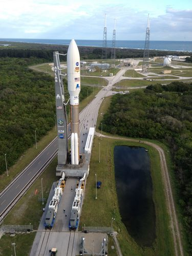 Backdropped by the Atlantic Ocean, the 197-foot-tall United Launch Alliance Atlas V rocket rolls toward the launch pad at Space Launch Complex 41 on Cape Canaveral Air Force Station in Florida. Atop the rocket is NASA's Mars Science Laboratory (MSL), enclosed in its payload fairing.
