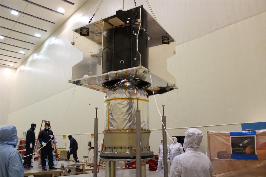The MAVEN spacecraft core structure is successfully lowered and mated to the hydrazine propulsion tank and boat tail assembly at Lockheed Martin, Denver.