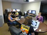 Women working at Malin Space Science Systems in San Diego, CA