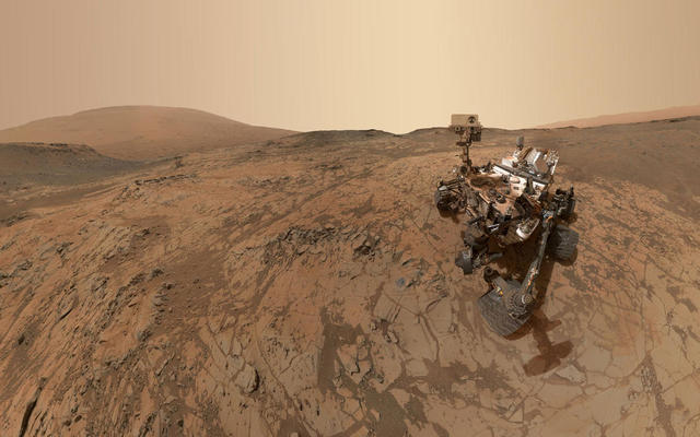 This self-portrait of NASA's Curiosity Mars rover shows the vehicle at the 'Mojave' site, where its drill collected the mission's second taste of Mount Sharp. The scene combines dozens of images taken during January 2015 by the MAHLI camera at the end of the rover's robotic arm.