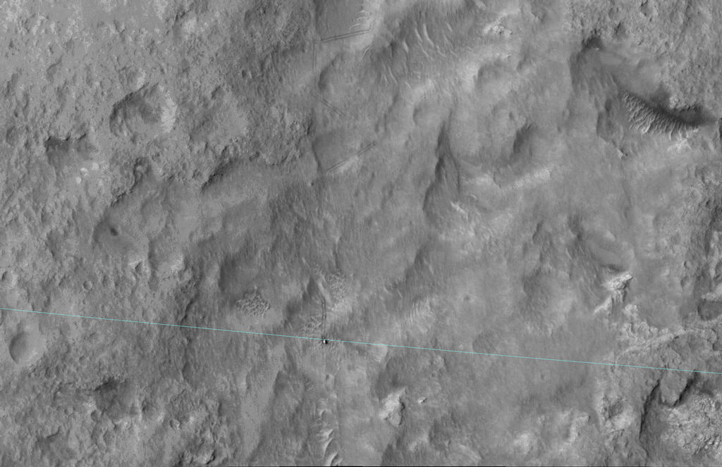 Curiosity-msl-landing-ellipse-edge-HiRise-This image shows Curiosity's landing area, rover tracks and a light blue line crosses showing the rover passing the landing-ellipse boundary.