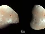 These color-enhanced views of Deimos, the smaller ot the two moons of Mars, result from imaging on Feb. 21, 2009.