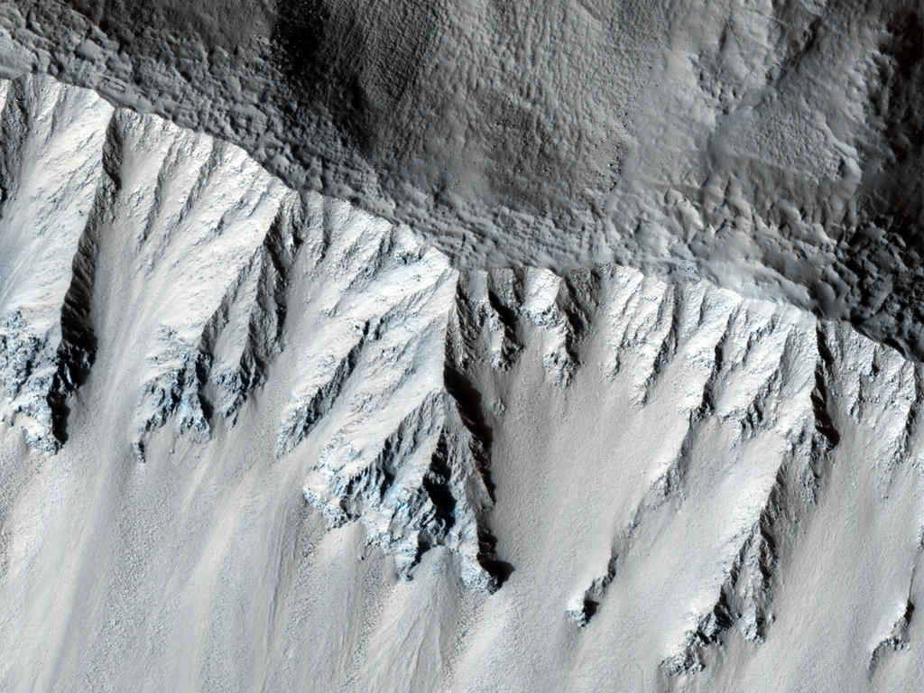 This fresh crater is located in the northern mid-latitudes. It is designated as fresh because of its very sharp rim.