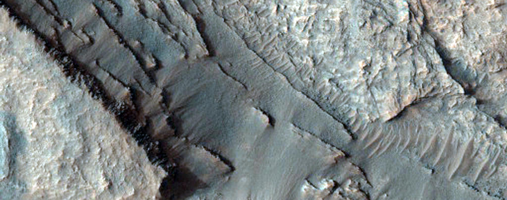 This image shows part of the floor of an impact crater on the northern rim of the giant Hellas Basin. 