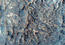 see the image 'Gullied Crater Slope with Rocky Outcrops Northeast of Hellas Region'