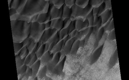 see the image 'Colliding Sand Dunes in Aonia Terra'