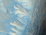 read the article 'Detailed Martian Scenes in New Images from Mars Orbiter'