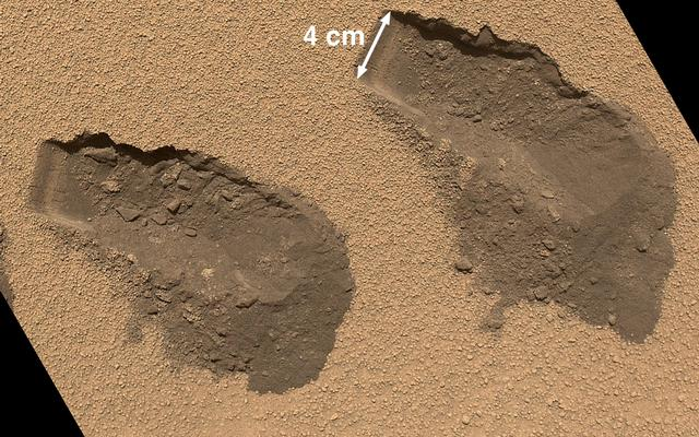 This is a view of the third (left) and fourth (right) trenches made by the 1.6-inch-wide (4-centimeter-wide) scoop on NASA's Mars rover Curiosity in October 2012