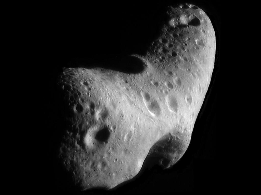 An image of a potato-shaped, gray asteroid with several craters on the surface.