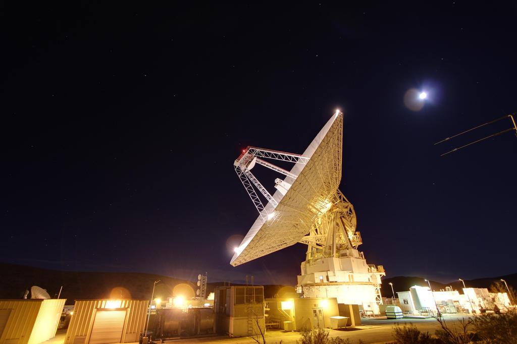 Late night in the desert: Goldstone's 230-foot (70-meter) antenna tracks spacecraft day and night. This photograph was taken on Jan. 11, 2012.