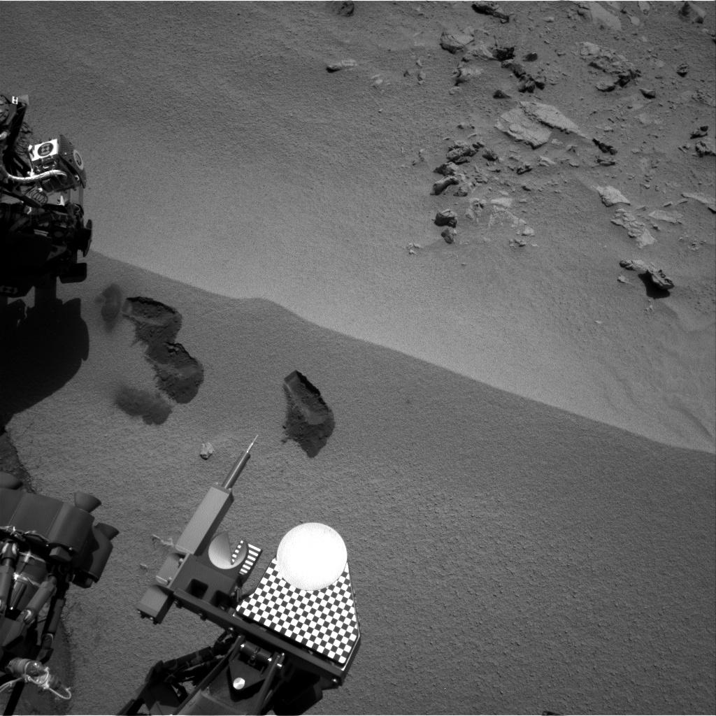 Three bite marks left in the Martian ground by the scoop on the robotic arm of NASA's Mars rover Curiosity are visible in this image taken by the rover's right Navigation Camera during the mission's 69th Martian day, or sol (Oct. 15, 2012).