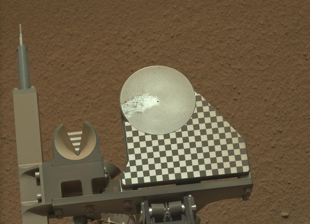 The robotic arm on NASA's Mars rover Curiosity delivered a sample of Martian soil to the rover's observation tray for the first time during the mission's 70th Martian day, or sol (Oct. 16, 2012)
