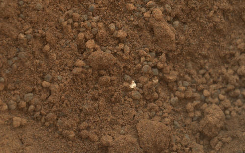 Bright Particle in Hole Dug by Scooping of Martian Soil